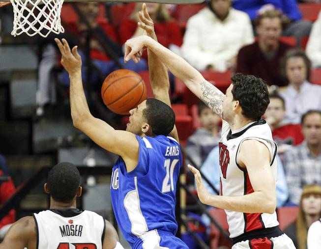 UNLV forward Carlos Lopez-Sosa blocks a shot by Air Force forward DeLovell Earls during their game Saturday, Jan. 12, 2013 at the Thomas & Mack. UNLV won in overtime, 76-71.