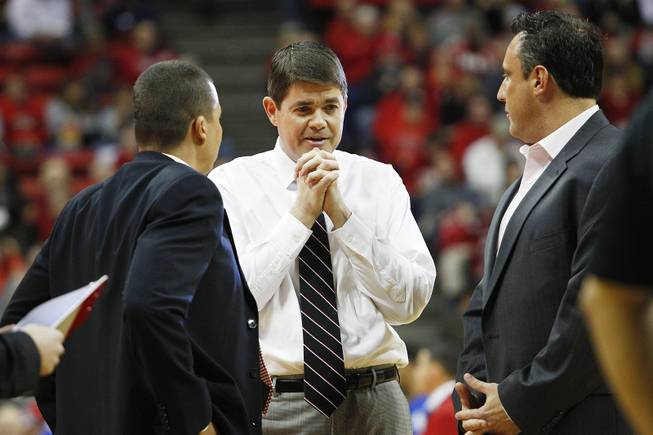 UNLV head coach Dave Rice talks with assistants Justin Hutson, left, and Heath Schroyer during a time out in their game against Air Force Saturday, Jan. 12, 2013 at the Thomas & Mack. UNLV won in overtime, 76-71.