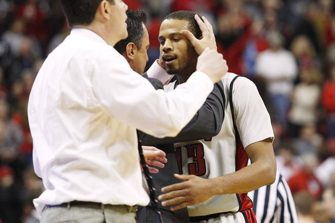 UNLV assistant coach Heath Schroyer grabs guard Bryce Dejean-Jones by the head after he sunk the go ahead basket in overtime against Air Force Saturday, Jan. 12, 2013 at the Thomas & Mack. UNLV won in overtime, 76-71.