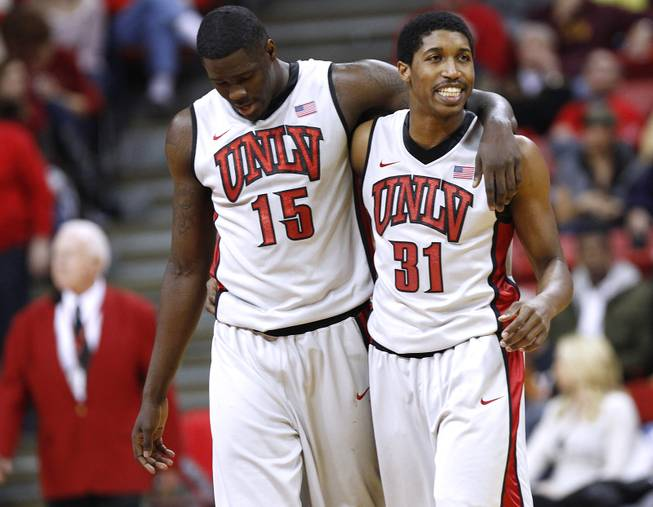 UNLV's Anthony Bennett walks off the court with his arm around teammate Justin Hawkins during their game against Air Force Saturday, Jan. 12, 2013 at the Thomas & Mack. UNLV won in overtime, 76-71.