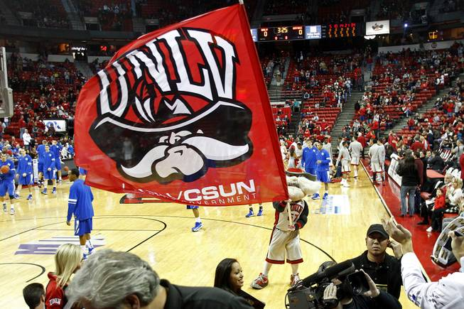 UNLV mascot Hey Reb waves a flag as the Rebels take the court at the Thomas & Mack for their home conference opener against Air Force Saturday, Jan. 12, 2013.