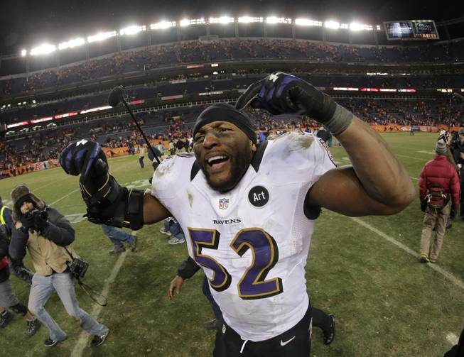 Baltimore Ravens inside linebacker Ray Lewis celebrates after the Ravens beat the Denver Broncos 38-35 in overtime of an AFC divisional playoff NFL football game, Saturday, Jan. 12, 2013, in Denver.