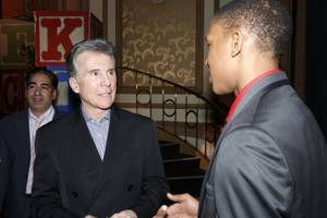 John Walsh talks with guests at the 14th annual Canon USA and NCMEC fundraiser at the Bellagio Grand Ballroom on Wednesday, Jan. 9, 2013.