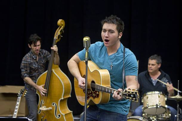 Tyler Hunter, center, performs as Elvis Presley during a rehearsal for
