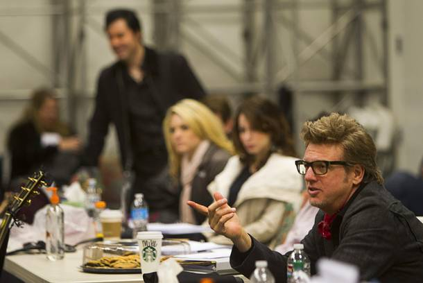 Musical director Chuck Mead, right, talks with cast members during a rehearsal for