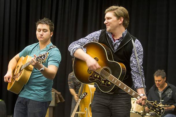 Tyler Hunter, left, as Elvis Presley and Benjamin D. Hale as Johnny Cash perform during a rehearsal for