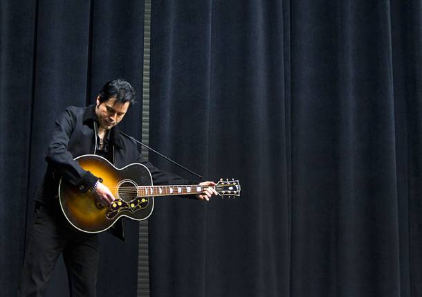 Cole, a Johnny Cash/Elvis Presley understudy, practices by himself during a rehearsal for
