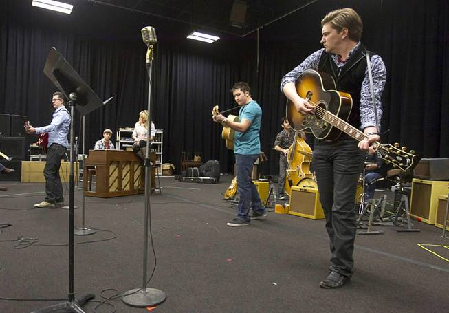 "Cast members rehearse for ""Million Dollar Quartet"" in a warehouse near The Orleans on Tuesday, Jan. 15, 2013. ""Million Dollar Quartet"" is based on a performance by Johnny Cash, Jerry Lee Lewis, Carl Perkins and Elvis Presley at Sun Records in Memphis on Dec. 4, 1956. The new show begins at Harrah's Las Vegas on Feb. 4."