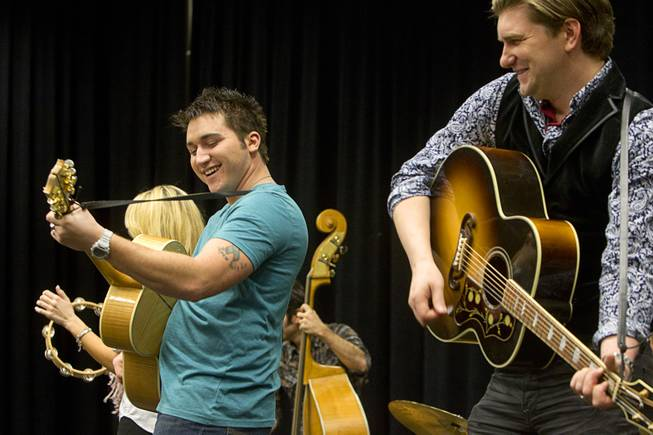 "Tyler Hunter, left, as Elvis Presley and Benjamin D. Hale as Johnny Cash perform during a rehearsal for ""Million Dollar Quartet"" in a warehouse near The Orleans on Tuesday, Jan. 15, 2013. ""Million Dollar Quartet"" is based on a performance by Johnny Cash, Jerry Lee Lewis, Carl Perkins and Elvis Presley at Sun Records in Memphis on Dec. 4, 1956. The new show begins at Harrah's Las Vegas on Feb. 4."
