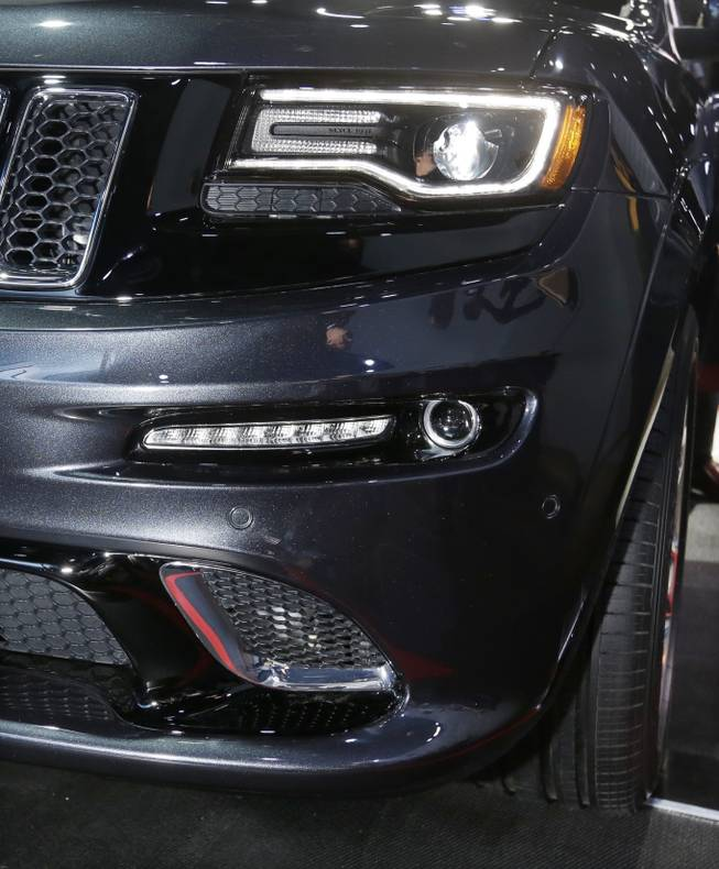 "The front lamps on the high-performance SRT version of the 2014 Jeep Grand Cherokee are seen at the North American International Auto Show in Detroit, Tuesday, Jan. 15, 2013. The lamps are tinted black, giving it a distinct look. Ralph Gilles, a Chrysler design leader who also is president and CEO of the SRT brand and motorsports, noted the vehicle has black ""kind of like death"", headlamps."