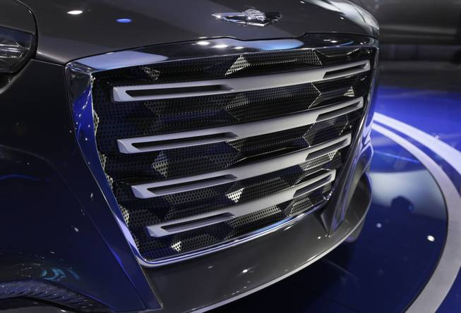 The front grill of the Hyundai HCD-14 Genesis Concept is displayed at the North American International Auto Show in Detroit, Tuesday, Jan. 15, 2013. Hyundai's new luxury concept car shows off at least a dozen small inverted triangles that appear behind horizontal bars. The wide-mouth grille has a bunch of tiny holes, and the angles reflect light. It's just one of many new styling cues on the HCD-14 Genesis, which Hyundai says is the direction it will take the next generation of its luxury cars, the Genesis and Equus.