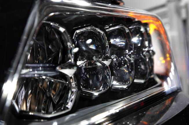A headlight on the 2014 Acura RLX is shown at media previews for the North American International Auto Show in Detroit, Tuesday, Jan. 15, 2013.