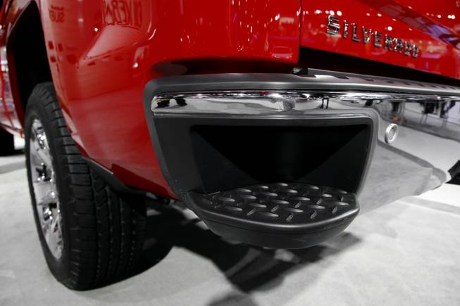 A 2014 Chevrolet Silverado with a step in the rear bumper is displayed at media previews for the North American International Auto Show in Detroit, Tuesday, Jan. 15, 2013.