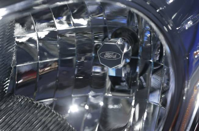 A headlight with a Ford logo is shown on the Ford Transit van at the North American International Auto Show in Detroit, Tuesday, Jan. 15, 2013.