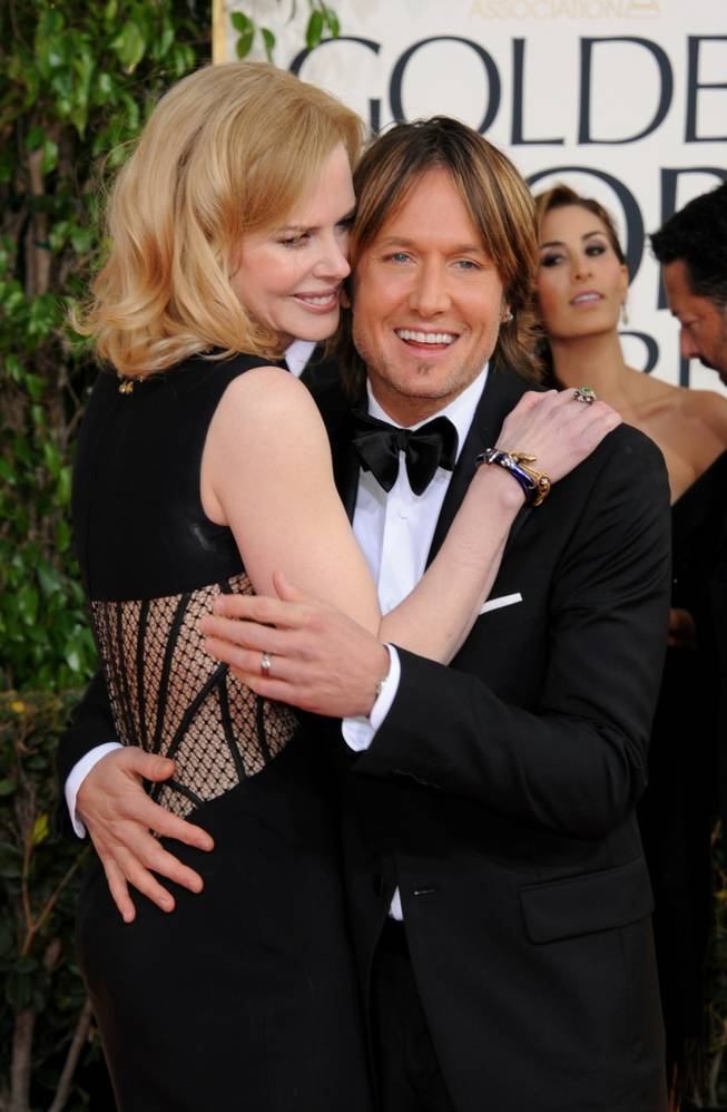 Musician Keith Urban and actress Nicole Kidman arrive at the 70th Annual Golden Globe Awards at the Beverly Hilton Hotel on Sunday Jan. 13, 2013, in Beverly Hills, Calif.