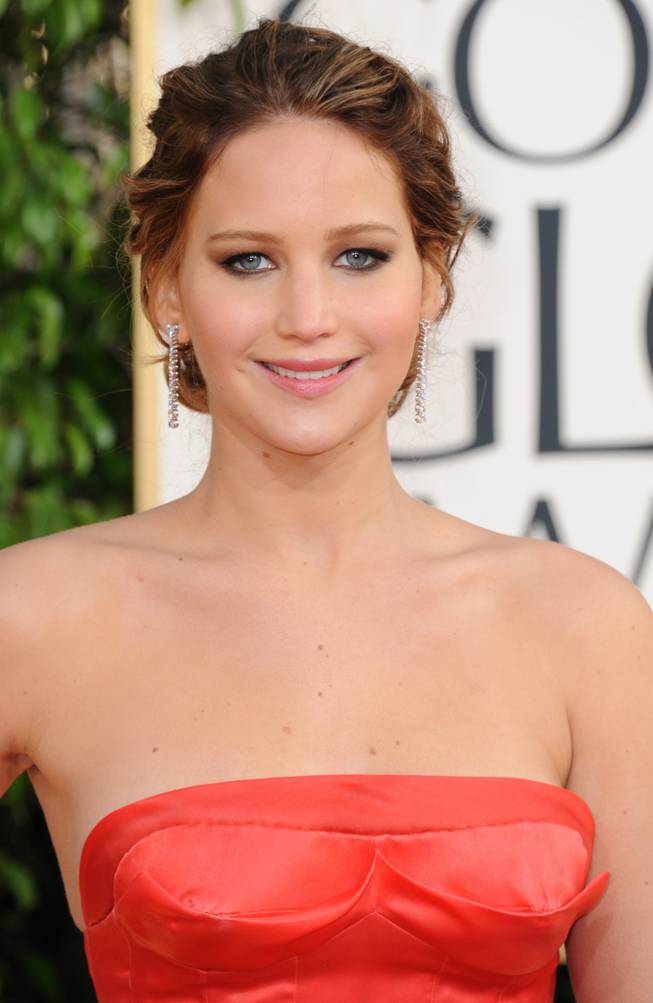 Jennifer Lawrence arrives at the 70th Annual Golden Globe Awards at the Beverly Hilton Hotel on Sunday Jan. 13, 2013, in Beverly Hills, Calif. (Photo by Jordan Strauss/Invision/AP)