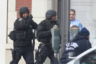 Police respond to the report of a shooting at Stevens Institute of Business and Arts in St. Louis on Tuesday, Jan. 15, 2013.