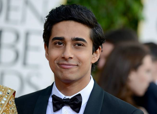 Suraj Sharma arrives at the 70th Annual Golden Globe Awards at the Beverly Hilton Hotel on Sunday Jan. 13, 2013, in Beverly Hills, Calif.