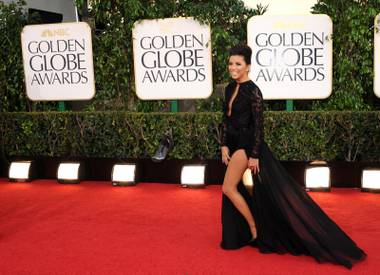 Eva Longoria arrives at the 70th Annual Golden Globe Awards at the Beverly Hilton Hotel on Sunday Jan. 13, 2013, in Beverly Hills, Calif.