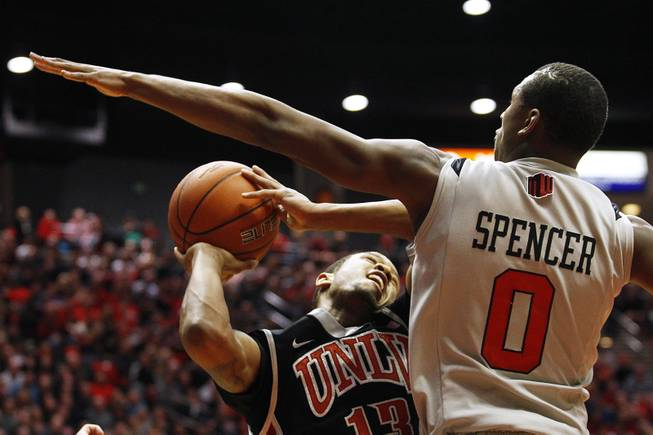 UNLV guard Bryce Dejean-Jones puts up a shot while being guarded by San Diego State forward Skylar Spencer during their game Wednesday, Jan. 16, 2013 at Viejas Arena in San Diego. UNLV upset SDSU 82-75.