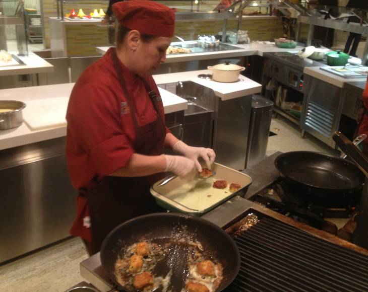 A cook prepares food to order on the Aria Buffet after renovations on Jan. 11, 2013.