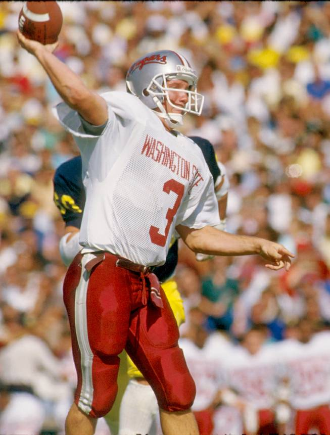 Former Washington State quarterback Timm Rosenbach attempts a pass for the Cougars. Rosenbach, who is the new UNLV offensive coordinator, finished seventh in the Heisman Trophy voting in 1988 and would go on to play several seasons in the NFL and CFL.