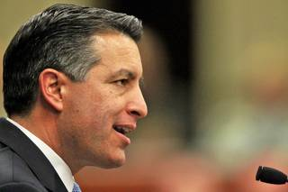 Nevada Gov. Brian Sandoval delivers the State of the State address at the Legislature in Carson City, Nev., on Wednesday, Jan. 16, 2013.