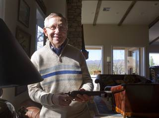 Senate Majority Leader Harry Reid (D-NV) holds a rusted pistol after an interview at his home in Searchlight, Nev. Thursday, January 17, 2013.