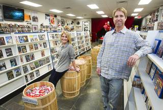 Trevor Layne and his girlfriend Katie Crispell pose at Movies & Candy, 10895 S. Eastern Ave., Thursday, January 17, 2013. Layne opened the video shop last November when his house started overflowing with movies.