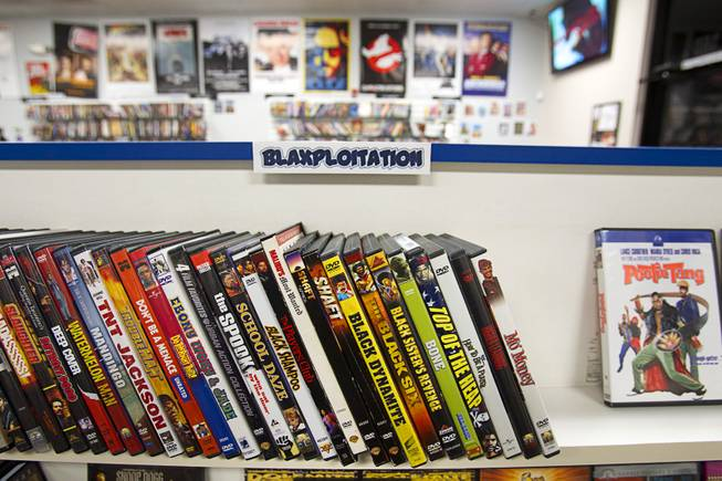"""Blaxploitation"" films are displayed at Movies & Candy, 10895 S. Eastern Ave., Thursday, January 17, 2013. Movie fan Trevor Layne opened the video shop last November when his house started overflowing with movies."