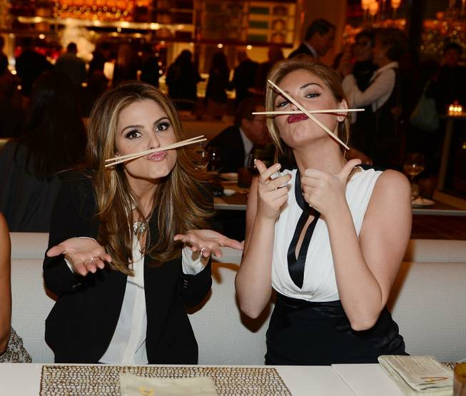 Maria Menounos and Kate Upton attend the grand opening of ...
