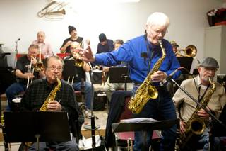 Roger Hall, 87, conducts fellow musicians while performing an alto sax solo during the Thursday Night Band jam session in The Garage in Henderson Thursday, January 18, 2013.