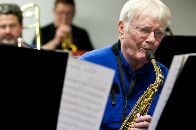 Roger Hall, 87, sight reads while playing the alto saxophone with other old-time big-band musicians during the Thursday Night Band jam session in the Garage in Henderson on Thursday, Jan. 18, 2013.