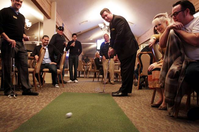 Dan Stafford participates in the putting contest during a Paradise Palms cocktail party at Las Vegas National Golf Club on Friday, January 18, 2013.