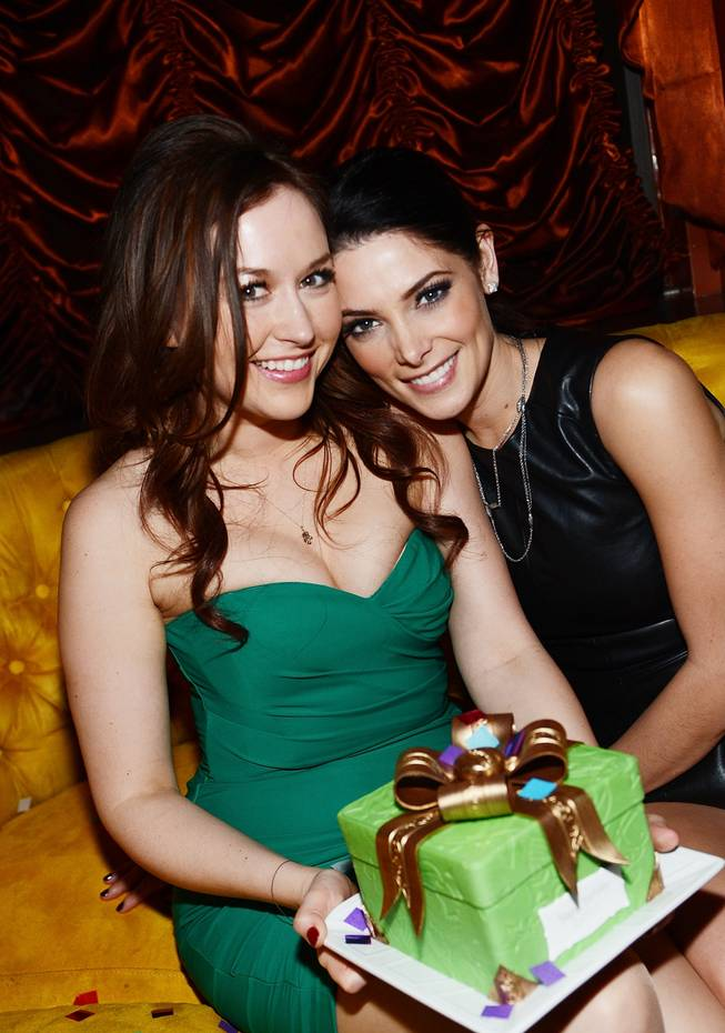 Ashley Greene, right, celebrates a friend's birthday at Surrender in the Encore on Wednesday, Jan. 16, 2013.