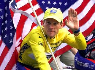 In this July 23, 2000, file photo, winner Lance Armstrong rides down the Champs Elysees after the final stage of the Tour de France cycling race in Paris.