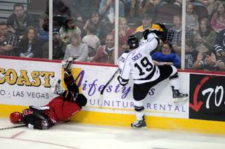 Fans react as Cameron Cooper hits the ice face-first after being upended by Joey Sides during the third period of play on Saturday night at the Orleans Arena.