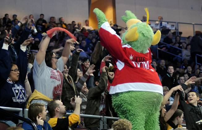 "Wrangler mascot ""The Duke"" entices fans to participate in starting a wave during a stoppage in play on Saturday night as Las Vegas hosted the Colorado Eagles at the Orleans Arena."