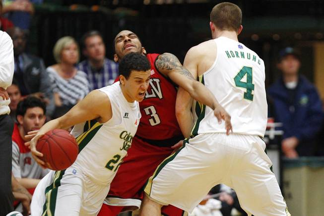 UNLV guard Anthony Marshall is screened by Colorado State forward Pierce Hornung as guard Dorian Green drives to the basket during their game Saturday, Jan. 19, 2013 at Moby Arena in Ft. Collins, Colorado.