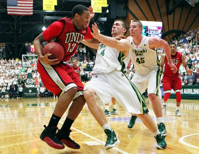UNLV guard Bryce Dejean-Jones fouls Colorado State forward Pierce Hornung late in their game Saturday, Jan. 19, 2013 at Moby Arena in Ft. Collins, Colo. Colorado State won the game 66-61.