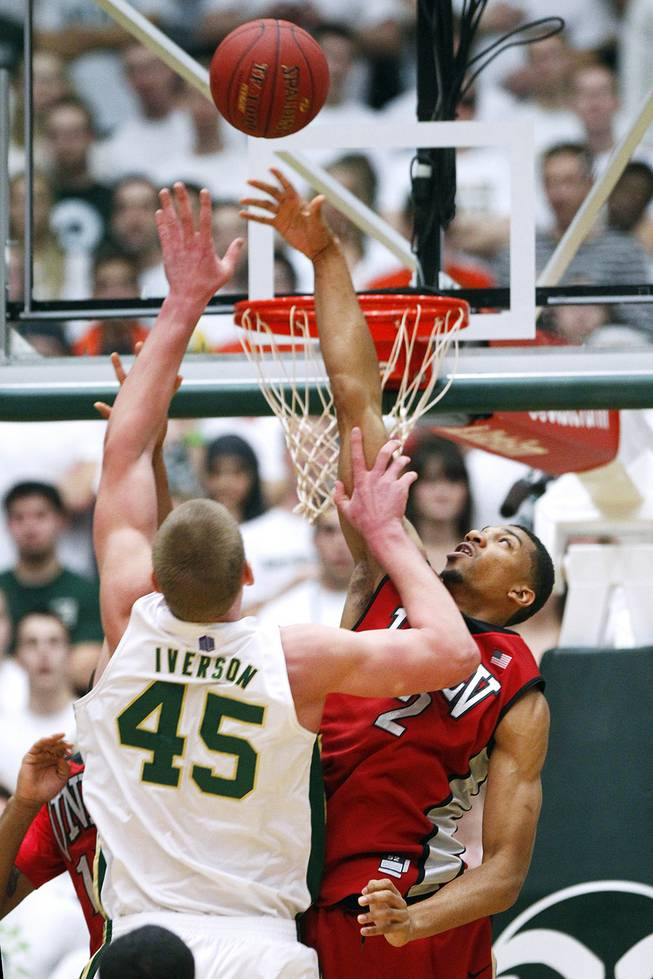 UNLV forward Khem Birch blocks a shot by Colorado State  forward Colton Iverson during their game Saturday, Jan. 19, 2013 at Moby Arena in Ft. Collins, Colo. Colorado State won the game 66-61.