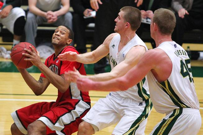 UNLV guard Bryce Dejean-Jones pulls up to make a shot while being defended by Colorado State forwards Pierce Hornung and Colton Iverson, right, during their game Saturday, Jan. 19, 2013 at Moby Arena in Ft. Collins, Colo. Colorado State won the game 66-61.
