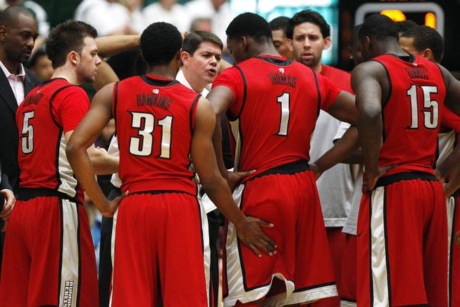 UNLV head coach Dave Rice talks to his team during a timeout in the Rebels' 66-61 loss to Colorado State on Saturday, Jan. 19, 2013, at Moby Arena in Fort Collins, Colo.