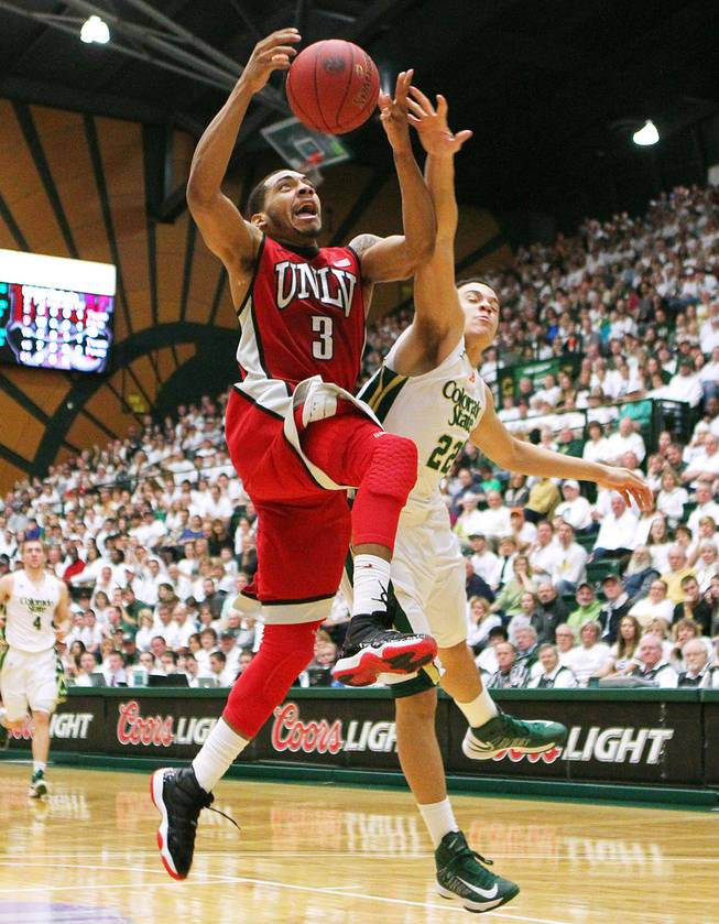 UNLV guard Anthony Marshall is fouled by Colorado State guard Dorian Green during their game Saturday, Jan. 19, 2013 at Moby Arena in Ft. Collins, Colo. Colorado State won the game 66-61.
