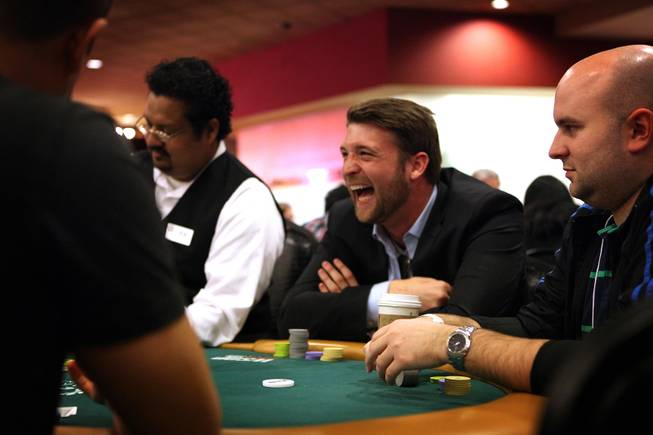 Mark Peters of Santa Clara University plays poker during the MBA Poker Championship and Recruitment Weekend at Planet Hollywood in Las Vegas on Saturday, January 19, 2013.