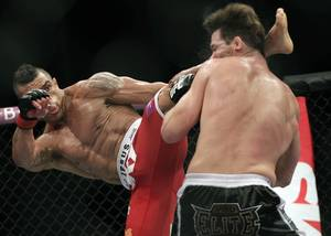Vitor Belfort, from Brazil, left, kicks Michael Bisping, from Britain during their middleweight mixed martial arts bout at the Ultimate Fighting Championship (UFC) in Sao Paulo, Brazil, Sunday, Jan. 20, 2013.