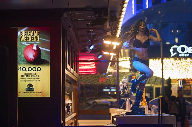 A dancer performs outside the Golden Gate casino in downtown Las Vegas, Sunday, Jan. 20, 2013.
