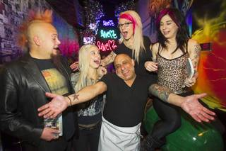 Chef Sammy D poses with adult film actresses and food critic Al Mancini during the second annual Burning Angel porn brunch at the Rattlecan restaurant in the Venetian Sunday, Jan. 20, 2013. Guests received a copy of Eating Las Vegas: The 50 Essential Restaurants written by Las Vegas food critics Mancini, John Curtas and Max Jacobson. Actresses from left are: Kleio, Jessie Lee, and Joanna Angel.