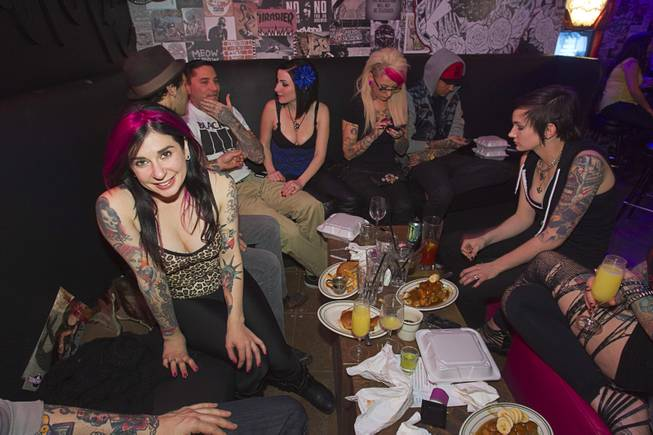 "Joanna Angel, left, poses during the second annual Burning Angel porn brunch at the Rattlecan restaurant in the Venetian Sunday, Jan. 20, 2013. Angel is the creator of the Burning Angel website, an adult site specializing in alternative porn. The brunch follows the AVN Adult Entertainment Expo which ended Saturday. About 40 guests joined adult film actresses as they downed signature ""Pickleback"" shots and rode a mechanical pickle, a drink concept that was inspired at the 2012 brunch."