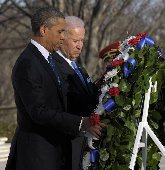 President Barack Obama and Vice President Joe Biden place a wreath at the Tomb of the Unknowns at Arlington National Cemetery in Arlington, Va., Sunday, Jan. 20, 2013.
